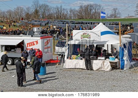 GORDONVILLE PENNSYLVANIA - March 11 2017: Annual spring auction `Amish Mud Sale` to benefit the Fire Company. Sale items include quilts antiques crafts food sporting goods tools farm equipment and horses.