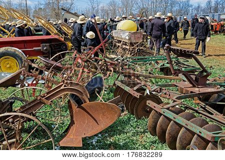 GORDONVILLE PENNSYLVANIA - March 11 2017: Farm equipment for sale at annual spring auction `Amish Mud Sale` to benefit the Fire Company. Sale items include quilts antiques crafts food sporting goods tools and horses.