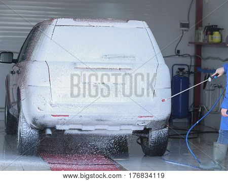 Car in a car washing station