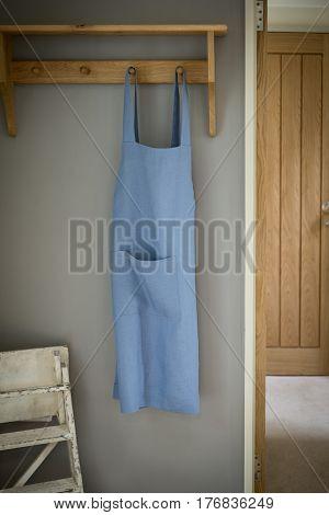 Blue Dress Hanging On A Wall Rack