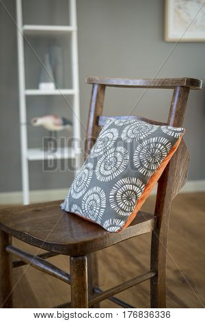 Square Pillow On A Vintage Wooden Chair
