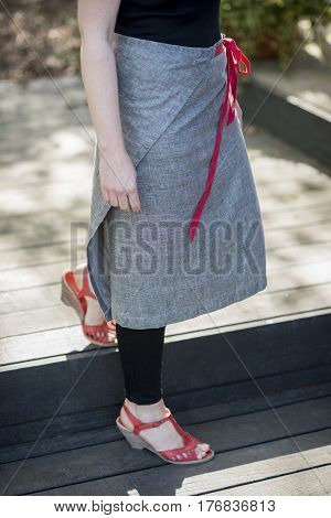 Wrap-around Gray Skirt With Red Cord Belt