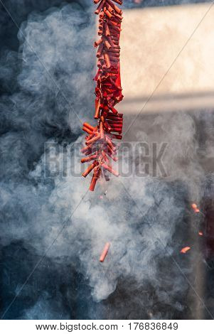 Exploding Chinese Firecrackers with Much Smoke .