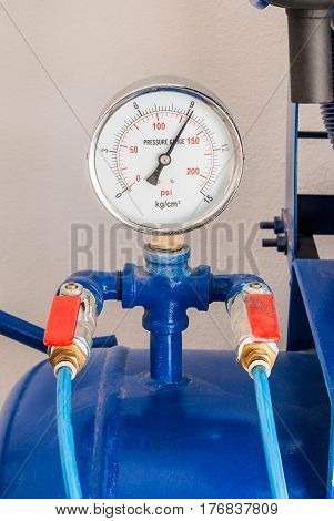 Closeup to Pressure Gauge of Air Compressor Tank