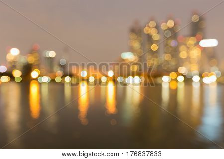 Blurred bokeh light night view office building abstract background