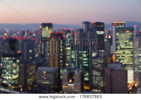Aerial view city of Osaka business downtown blurred light night view abstract background