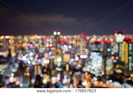 Blurred bokeh light Osaka city downtown with twilight skyline background