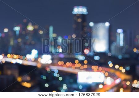 Night city blurred bokeh lights aerial view city business downtown abstract background