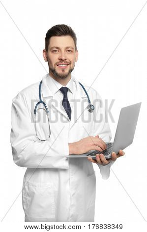 Handsome doctor working with laptop on white background