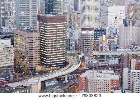 Close up aerial view office building business downtown and highway Osaka Japan