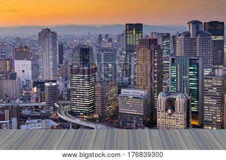 Opening wooden floor City office central business downtown with mountain background Osaka Japan