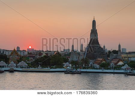 Sunset at Wat arun ratchawararam on Chao phraya river front Bangkok Thailand Landmark