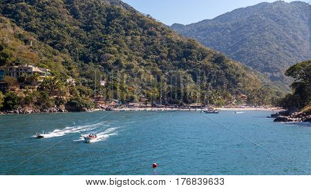 Water taxi's leave Boca de Tomatlin on Mexico's Pacific coast