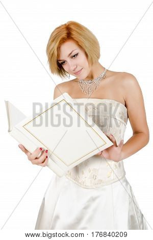 Happy girl in a white evening dress and necklace. Bare shoulders. Butch. Isolated on white background