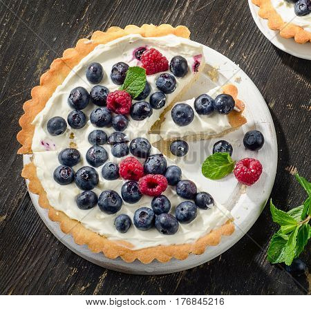 Tart With Berries And Whipped Cream.