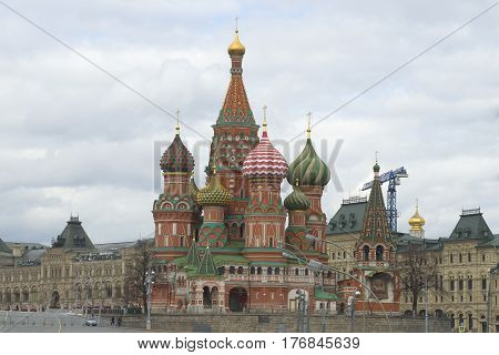Cathedral of the Intercession of the Blessed Virgin (Basil the Blessed) against the background of a cloudy sky. Moscow
