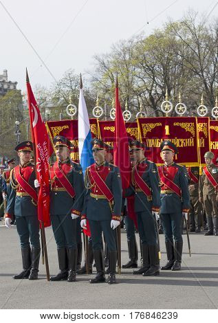 SAINT PETERSBURG, RUSSIA - MAY 05, 2015: A group of soldiers with banners. Rehearsal of parade in honor of Victory Day in St. Petersburg