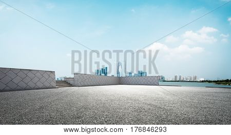 empty road and cityscape of modern city in blue sky
