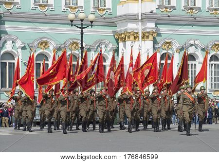 SAINT PETERSBURG, RUSSIA - MAY 05, 2015: A group of soldiers with banners-participants of the great Patriotic war on rehearsal of parade in honor of Victory Day