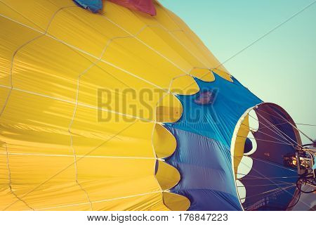 Close-up of Hot Air Balloons with fire with sky background applying retro and vintage filter effect styles.