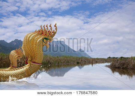 Nine head of serpent statue in Wat Thailand. A Buddhist religious belief. Animals imagination in fairy tale.