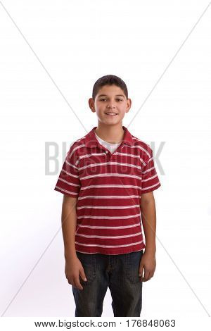 Hispanic young boy jumping isolated on white.