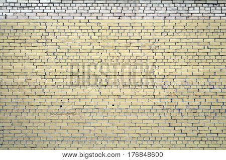 Light yellow curve brick wall for texture and background.