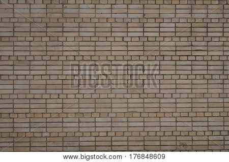 Brown curve brick wall for texture and background.