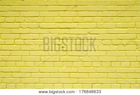 Old brick brick wall painted with yellow paint for textures or backgrounds.