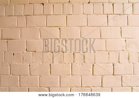 Old brick brick wall painted with pink paint for texture and background.