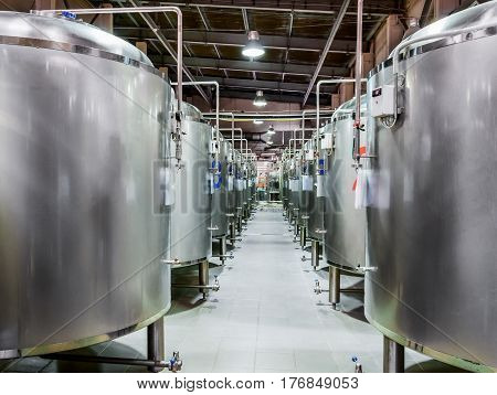 Modern Beer Factory. Steel tanks for beer fermentation and storage.
