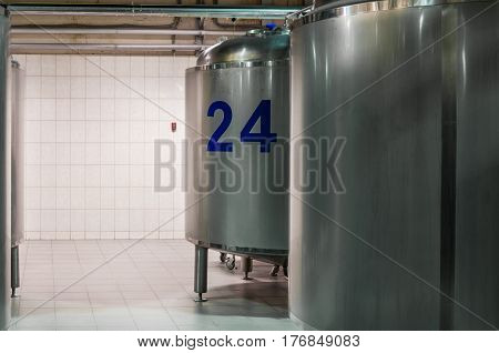 Modern Beer Factory. Small steel tanks for storage and fermentation of beer.