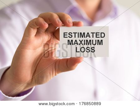 Businessman Holding A Card With Estimated Maximum Loss Message