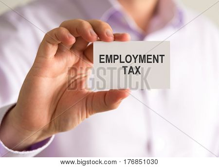 Businessman Holding A Card With Employment Tax Message