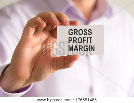 Businessman Holding A Card With Gross Profit Margin Message