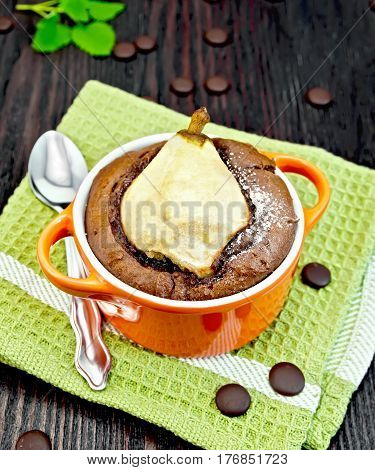 Cake Chocolate With Pear In Red Bowl On Green Napkin