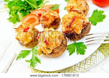 Champignons Stuffed With Meat And Peppers In Plate On Light Board