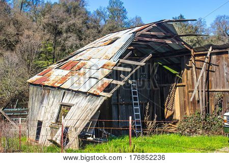 Vintage Rusty Tin Roof Barn With Collapsed Front