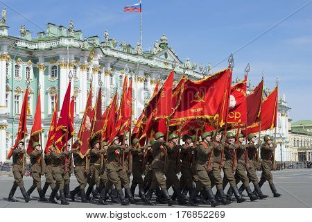 SAINT PETERSBURG, RUSSIA - MAY 05, 2015: Soldiers with flags on the Palace square. Rehearsal of parade in honor of Victory Day in St. Petersburg