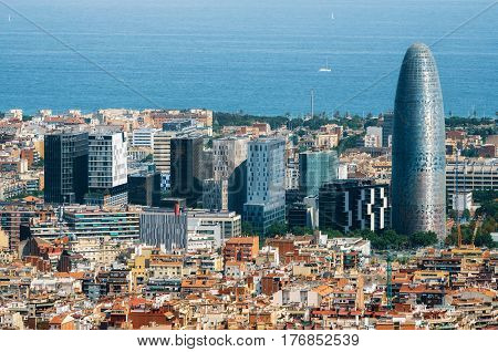 Scenic aerial cityscape with the Agbar Tower and skyscrapers in Barcelona in Spain