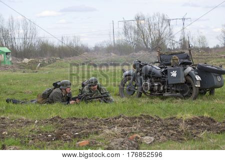 SAINT PETERSBURG, RUSSIA - MAY 05, 2015: Lying German motorcyclists. Reconstruction of the episode of the great Patriotic war