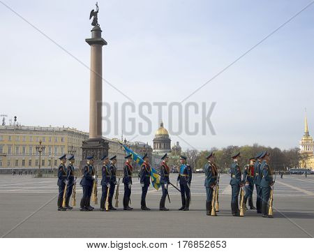 SAINT PETERSBURG, RUSSIA - MAY 05, 2015: Soldiers with flags in front of the rehearsal of the Victory parade. Saint Petersburg
