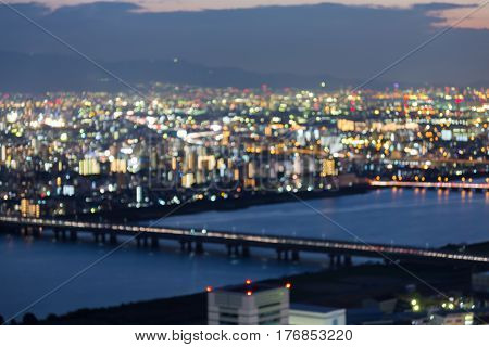 Night blurred light aerail view Osaka city downtown abstract background