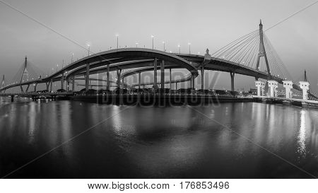 Panorama Suspension bridge with water reflection with twilight sky background Bangkok Thailand Black and White tone
