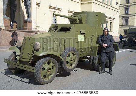 SAINT PETERSBURG, RUSSIA - MAY 05, 2015: Soviet armored car BA-3 and his driver