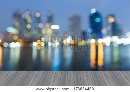 Opening wooden floor blurred bokeh city office light night view abstract background