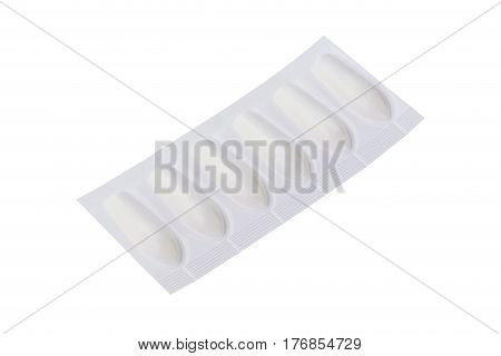 The suppository in pack on white background