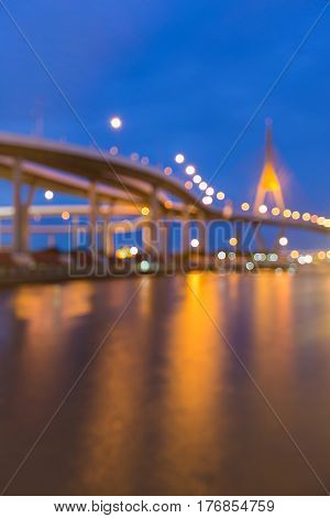 Twilight blurred bokeh highway and bridge river front abstract background