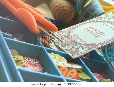 Box with accessories for needlework. Close up. Small depth of sharpness.Clarification of edges. Horizontal format. Color. Photo.