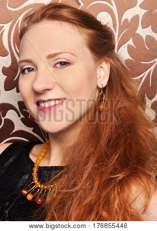 Portrait of a smiling happy young beautiful red-haired girl